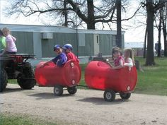 How to Make a Trailer From Plastic Barrels  @ Roberta DeFord - I saw these today only they used old oil drums.  They made a whole train and it was so cute.  Made me think of Dad - I bet he could do something like this