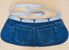 Ridiculously easy jeans apron.  If you're not picky about the edges, this could be accomplished with a pair of scissors and a ribbon.  Only drawback is that it makes you look like your butt is in front.  :)
