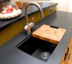 """Thought Richlite was only useful as a countertop? Think again! It is extremely durable, water resistant, and machinable, making it an excellent application for a sink of any kitchen. This """"turbo charged wood,"""" as we like to call it, can be cut with a standard CNC machine to produce any desired detail or shape. Featured here is an expertly designed residential kitchen in High Falls, NY that was fabricated by Catskill Woodworking."""