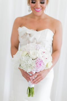 White bouquet with a touch of pink: http://www.stylemepretty.com/destination-weddings/2015/02/23/glamorous-cancun-wedding/ | Photography: Ashley McCormick - http://www.ashleymccormick.com/