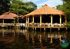 Hotel Laguna Lodge in Tortuguero Costa Rica. Tortuguero is in Costa Rica's northern Caribbean zone, a wild and lush area of canals, jungle and incredible wildlife. The environmentally conscious jungle lodge has a unique sense of style with its artistic details and design.