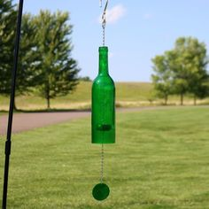 Glass bottle wind chime - Glass bottle with iridescent shell wind catcher - Includes 1 indoor/outdoor wind chime - Great gift for wine enthusiasts - Makes a beautiful decorative accent for your garden or patio - Overall wind chime is diameter x H; Liquor Bottle Crafts, Liquor Bottles, Glass Bottles, Wine Glass, Glass Art, Vodka Bottle, Wine Bottle Centerpieces, Gnome Statues, Altered Bottles