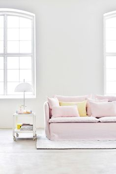 pale pink and yellow are our favourite spring colours | arched industrial windows | white walls and concrete floors | linen ghost gervasoni inspired sofa | IKEA Söderhamn sofa with a Bemz Loose Fit cover in Pearl Brera Lino by Designers Guild