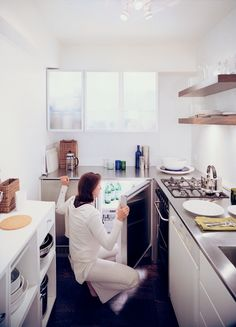 Goolrick reoriented the kitchen and chose sleek stainless steel countertops and bright white walls and cupboards to create the illusion of space. Solutions For Tiny Kitchens by Aileen Kwun from Urban Vessel. Browse inspirational photos of modern homes.