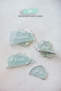 DIY sea glass place cards  #calligraphy, #silver, #diy, #place-cards, #glass    Read More: http://www.stylemepretty.com/living/2014/05/22/how-to-host-a-potluck-dinner-diy-seaglass-place-cards/