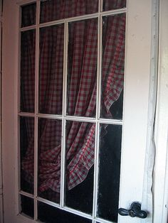 Door with red gingham curtain