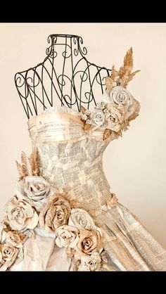 Absolutely gorgeous wire mannequin, wrapped a dress made of old pages and papers, and adorned with paper flowers.