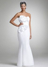 Unique and elegant, wow your guests on your special day in this beautiful satin gown!  Strapless satin slim mermaid gown features eye-catching cascade ruffle detail on bodice.  Available in White.  Fully lined. Back zip. Imported polyester. Dry clean only.
