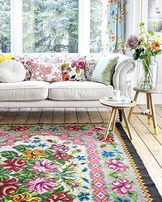 You can purchase really attractive rugs at Target or Wal-Mart, to brighten any room. #floral #interiors #home #cushions #sofas #chairs #walls #pillows #mirror #yourhomemagazine