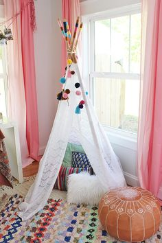 kids-teepee- LOVE this adorable colorful feminine playroom.  the pink curtains are awesome!