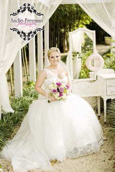 Bridal portrait in front of vintage white vanity under white majesty canopy.  Classic Fall Wedding.  Photography:  Andie Freeman Photography www.TheAthensWeddingPhotographer.com  Coordinating:  Wild Flower Event Services Venue:  The Thompson  House and Gardens, Bogart, GA Floral:  Flowers by On