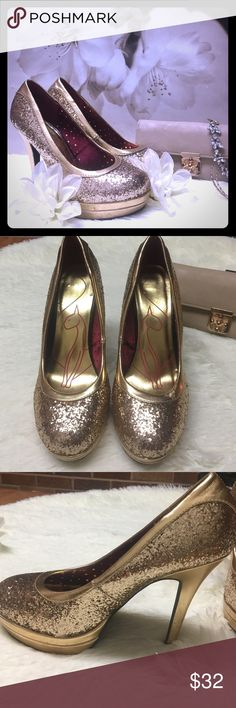 BLACK FRIDAY SALE!!! Baby Phat brand- comes with original box- only worn once! These are stunning gold sparkle stilettos with a 5in platform heel- these are perfect for NYE or any holiday party where you really want to look FABULOUS!!!! Baby Phat Shoes Heels