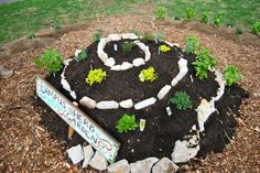 """Spiral Herb Garden; """"[M]elding colonial style with a modern permaculture twist and putting sustainability in a local context while introducing an innovative, bio-intensive method to traditional gardening."""""""
