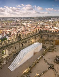 Positioned within mighty walls, the visitors centre at Castelo de Pombal in Portugal harmoniously attunes the new with the old. Portugal, Contemporary Architecture, Landscape Architecture, Visual Arts Center, Youth Center, Castle Wall, Exterior, Built Environment, Modern Buildings