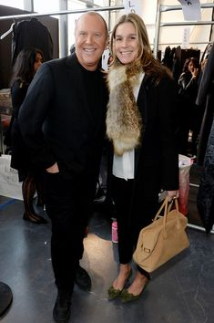 Aerin Lauder Designer Michael Kors (L) and director of style and image at Estee Lauder Aerin Lauder prepares backstage at the Michael Kors f...