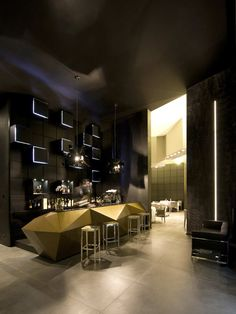 Inkiostro Restaurant / Studio Nove & A2C. Brass bar. Modern angular shape. Willow project inspiration.