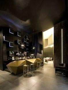 Inkiostro Restaurant / Studio Nove & A2C. Brass bar. Modern angular shape. Willow project inspiration.