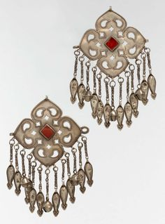 Iran or Central Asia | Pectoral Ornament  | 20th century | Silver, fire gilded with openwork, wire chains, embossed pendants bells, and table cut carnelians.