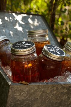 Juice and Jars.  guests can take this old-fashioned glassware with custom labels off the camp grounds and back home as a souvenir.