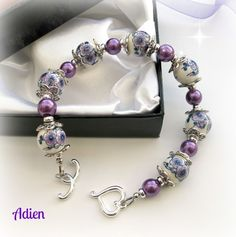 Purple Bracelet Ceramic flowers £10.95