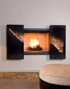 Cette cheminée murale apportera à votre pièce une touche de modernité et d'originalité.  http://www.m-habitat.fr/cheminees/styles-de-cheminees/cheminee-stella-par-jc-bordelet-162_B
