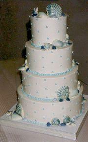 Dainty beach themed wedding cake. #pastel