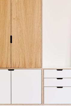 Close up of oak veneer and white laminate bespoke wardrobe by Lozi. Lozi offers a fantastic selection of fitted wardrobes and can design and fit your perfect one. All our wardrobe designs are completely tailored to fit your needs, from adapted storage through to the choice of materials.