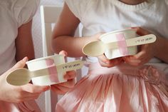 """We took white ice cream cups and taped wooden """"i ♥ ice cream spoons"""" on them with striped washi tape! The girls got to make their own sundaes, which they loved! Then they got to fill up their bakery boxes with treats to bring home!"""