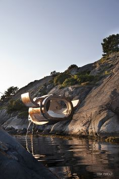 To be allowed to sleep in this hovering cabin, you must be newly married. Perhaps this is a little piece of paradise on this earth. The cabin has been mounted many places and in many different situations. This is in the idyllic Norwegian coast of Grimstad. In 2014 it was exhibited in the Palais de Tokyo in Paris. To see more works by Erik Pirolt: http://pirolt.org
