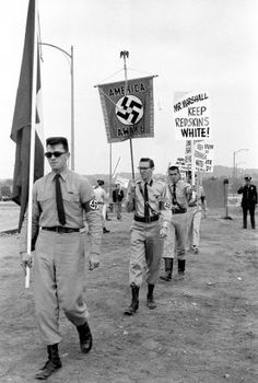 """Keep Redskins White!"" Members of the American Nazi Party demonstrate against desegregating the Washington, DC, football team, October 1961. Currently, Washington, DC's pro football team, the Redskins, has the distinction of being the only team in the NFL whose name is a racial slur. A little more than 50 years ago, it had another unfortunate distinction: It was the last remaining all-white team in the league.  Photo by Neil Leifer/Sports Illustrated/Getty Images"