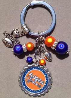 This+listing+is+for+one+Florida+Gators+bottle+cap+key+chain.    This+key+chain+is+embellished+with+orange+and+blue+shiny+beads,+a+football+charm+and+an+I+Love+Football+charm.    You+may+choose+from+any+image+in+the+collage!+Just+leave+me+a+note+during+checkout!!    Have+a+great+day!    Laura