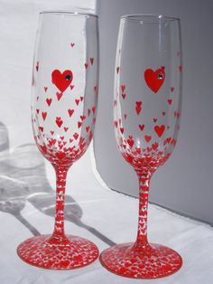 champagne flutes hand painted with red hearts and embellished with Swarovski crystals