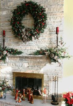 Love the greenery arrangement aroound candle sticks..........                 Christmas Fireplace/Mantle