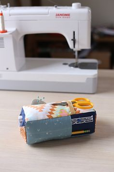 Carry-all Pincushion from book Handmade Style by Anna Graham, fabrics are Wanderer by April Rhodes. (Carryall Pincushion 12/15)