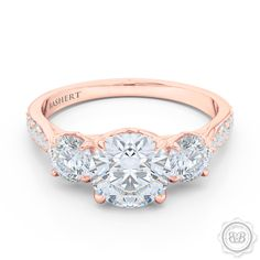 Classic Lines and Mesmerizing Design. Three-Stone Open Hearts Engagement Ring. Handcrafted in Romantic Rose Gold. GIA Certified Diamonds, Tailored to Your Budget. Celebrate Your Past-Present-Future with This Award-Winning Design. Free Shipping USA.  30Day Returns | BASHERT JEWELRY | Boca Raton Florida