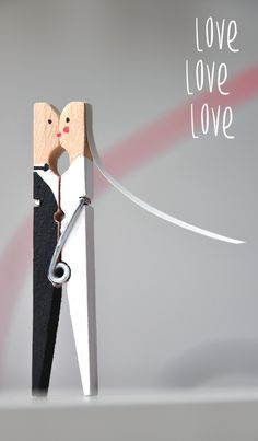 Cute Clothes Pin Bride and Groom!  You can make a bunch to hold escort cards, make one for each table to hold your table numbers or make one or two to hold a sign (maybe instructions for signing your guest book or where to sit for your ceremony).