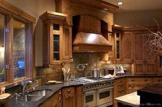 Rustic Kitchen Design with Pro Viking Range, Large Wood Hood, and Slate Tile Backsplash  (Kitchen-Design-Ideas.org)
