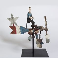 AMERICAN FOLK ART PATRIOTIC-PAINTED PEDDLE BOAT AND DRIVER WHIRLIGIG