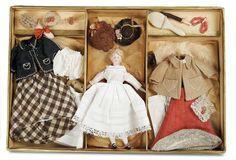 german dollhouse doll with trousseau
