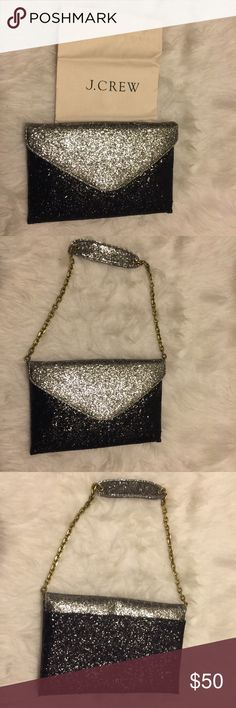 Glittered JCrew envelope clutch Multi-function black and silver glittered JCrew envelop clutch with shoulder handle that could be hidden from view. Wear it two ways - as a clutch or as a shoulder bag. Great accessory for formal occasions and roomy enough to for your phone, wallet and other necessities. Snap closures on front flap and back pocket and zippered interior pocket. Never been worn. Dust bag is included J. Crew Bags Clutches & Wristlets