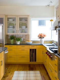 Not my usual kitchen, but something about this fun tile and bright cabinets just makes me happy!