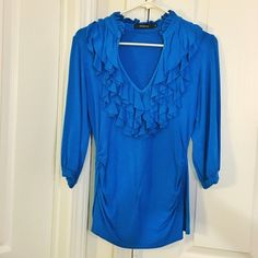 Arden B ruffle top Beautiful blue top. Very flattering. Stretchy fabric. Sleeves are 3/4 Arden B Tops Blouses
