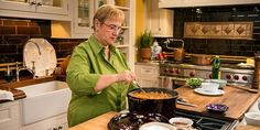 Lidia prepares a baked Penne dish with Pork Ragu and Zucchini topped with a crust of Cheese.