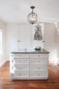5061dac6 Kate Maloney Interior Design - Amazing walk-in closet features a Currey and  Co Crystal Bud Sphere Chandelier illuminating a white closet island fitted  with ...