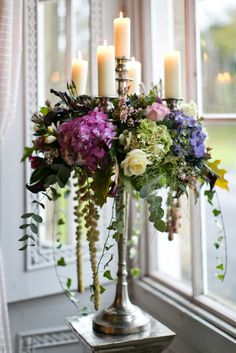 Gorgeous hydrangea-adorned candelabras from Flower Design Events, UK (Love those slim pillar candles too!)