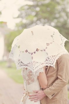 a hidden kiss with a lace umbrella