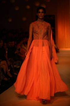 Apple of ones eye. Neon still does the trends after Sheer and Lace this season. Manish Malhotra | LakmeFashionWeek2013