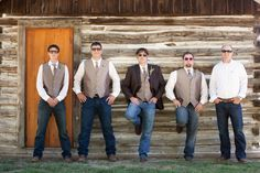 casual groomsmen style with jeans and brown vests and blazers. ~ click for more from a DIY Montana Wedding