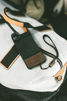 Travel essentials for any photographer: Moment lens, case, + strap for your phone