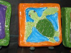 "5th grade clay relief sculpture (7"" X 7""x 1.5""), ceramic glazed.  Lesson designed by Susan Joe (Steiner Ranch Elementary Art Teacher)"